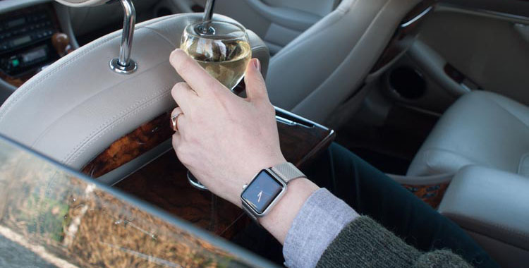 aWatch with Milanese strap and a glass of Sancerre